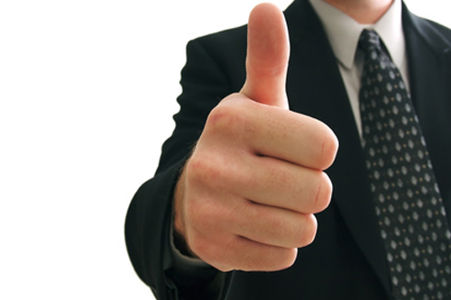 A thumbs up, representing a positive client testimonial.
